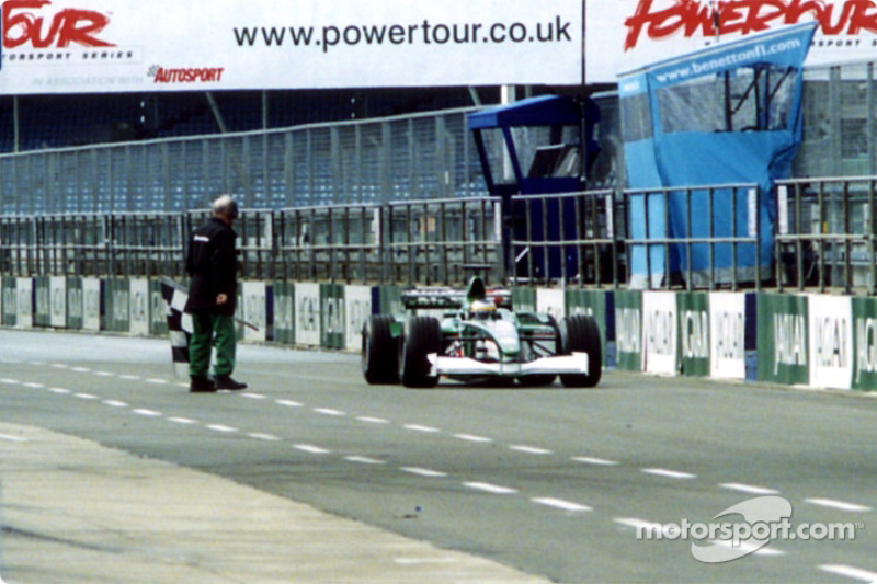 Pedro de la Rosa is warned by a marshal for staying out after the chequered flag