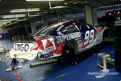 Jef Burtons battered Ford Taurus lies alone in the garage area after the team rolled out a back up car for The Winston following a first lap crash. As no laps had been completed NASCAR allowed teams to use their back up cars.