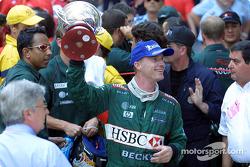 Eddie Irvine celebrating his 3rd place