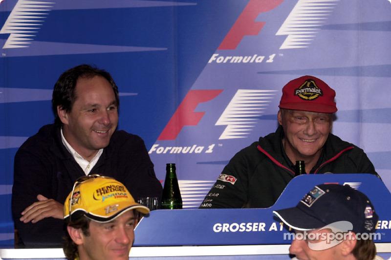 Press conference: Gerhard Berger, Niki Lauda having fun at the back, Jarno Trulli and Jenson Button