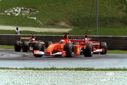 Michael Schumacher and Rubens Barrichello, under pressure by Jos Verstappen