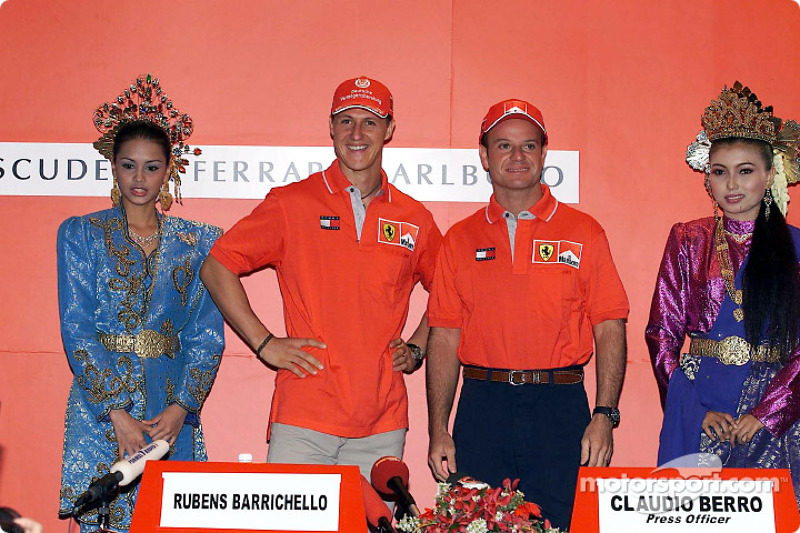 Michael Schumacher and Rubens Barrichello, with local beauties