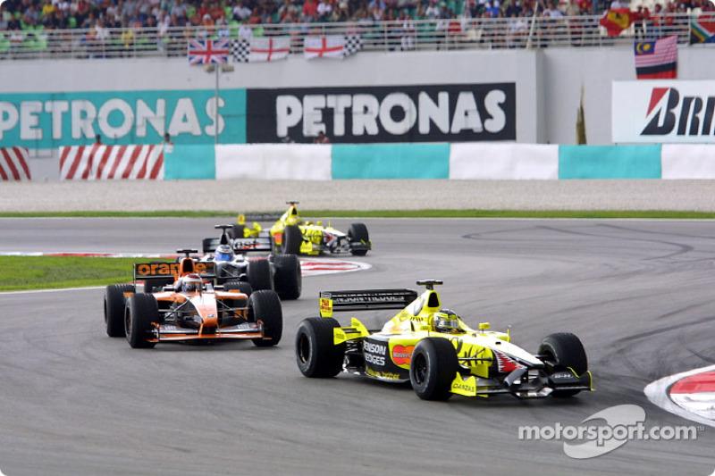 Heinz-Harald Frentzen and Jos Verstappen in front of a Mclaren
