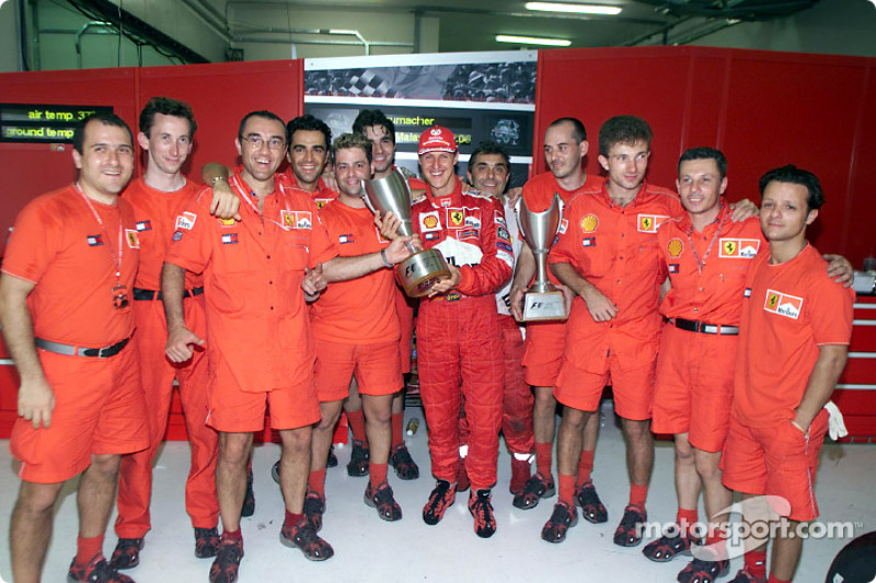 Michael Schumacher and Team Ferrari celebrating after the race