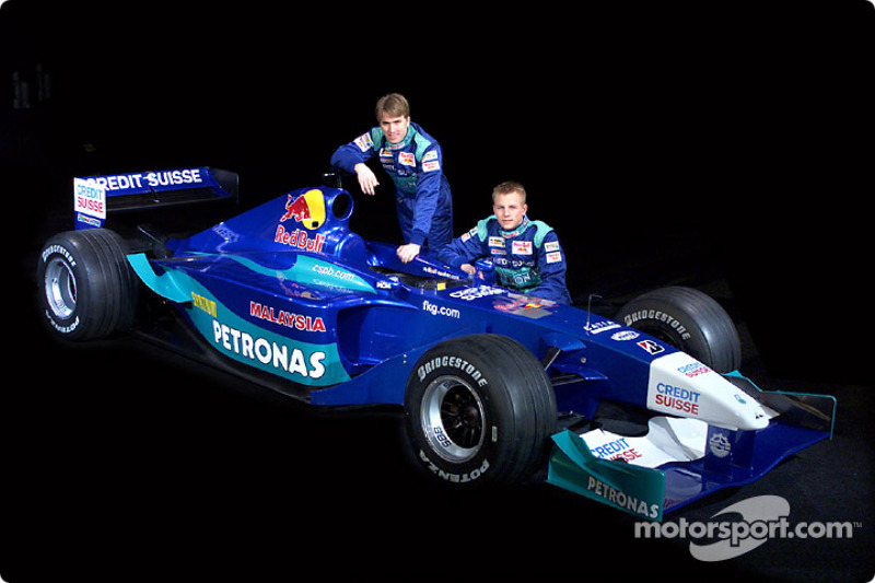 The Sauber C20 and the 2001 drivers: Nick Heidfeld and Kimi Raikkonen