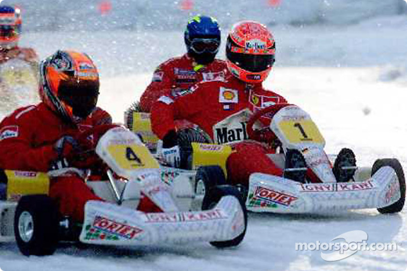 Max Biaggi races against Michael Schumacher