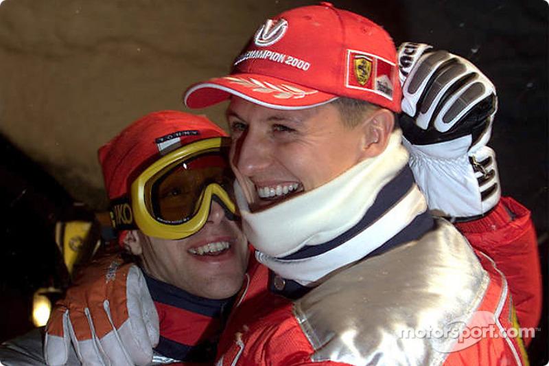 Michael hugs Ferrari's test-driver Luca Badoer