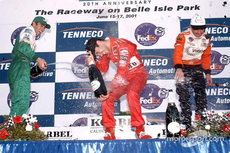The podium: Dario Franchitti, Helio Castroneves and Roberto Moreno