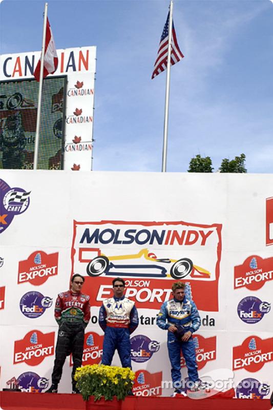 The podium: Adrian Fernandez, Michael Andretti and Alex Tagliani