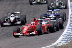 Rubens Barrichello, Ferrari F2001, Mika Hakkinen, McLaren MP4-16, David Coulthard, McLaren MP4-16