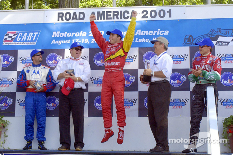 The podium: Michael Andretti, Chip Ganassi, Bruno Junqueira and Adrian Fernandez