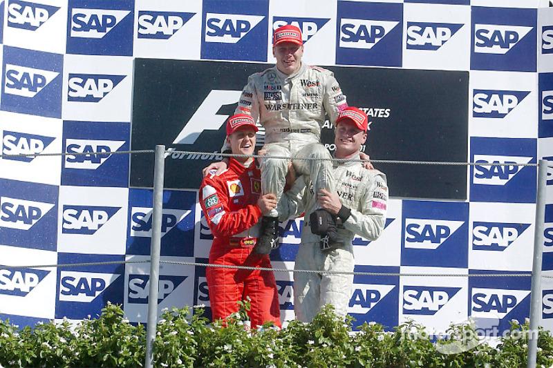 The podium: race winner Mika Hakkinen with Michael Schumacher and David Coulthard