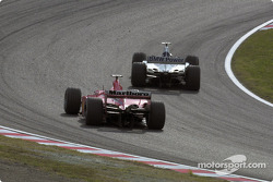 Juan Pablo Montoya passing Rubens Barrichello