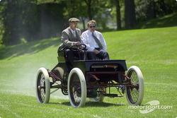 Glenn Miller, development engineer at Ford Special Vehicle Engineering, and Edsel B. Ford II cruise around the activities field in a Ford 1901 Sweepstakes restored vehicle