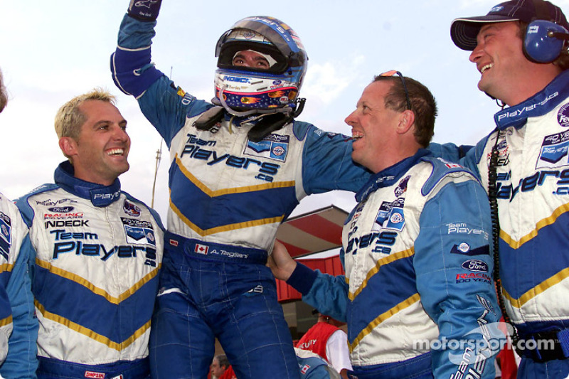 Alex Tagliani celebrating his podium finish with his crew