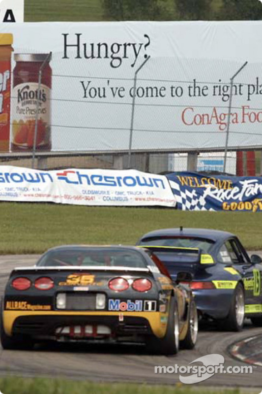 The Motorsport Technologies and Phoenix American Racing cars taking a tight turn