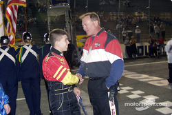 Flagman Buddy Burkett shakes hands with competitor Jason Petty