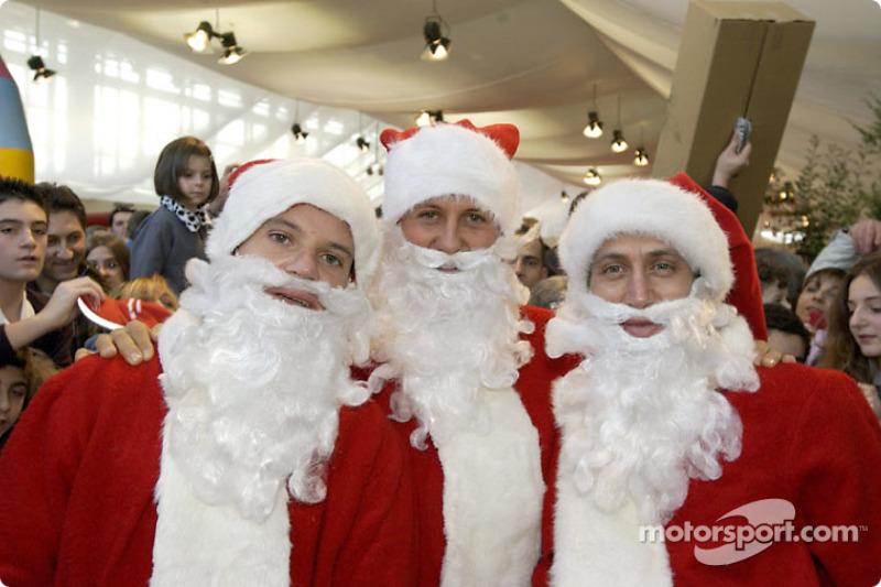The traditional Children's Christmas at Ferrari: Rubens Barrichello, Michael Schumacher and Luca B