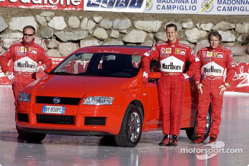 Rubens Barrichello, Michael Schumacher and Luca Badoer with the Fiat Stilo