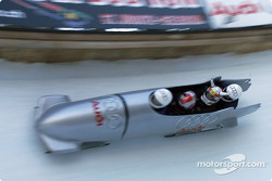 Swapping an Audi racer for an Audi bobsled: Rinaldo Capello and Tom Kristensen riding down the Olympic run in St. Moritz