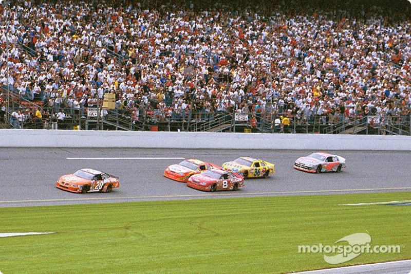 Tony Stewart leading Dale Earnhardt Jr. and Jeff Gordon