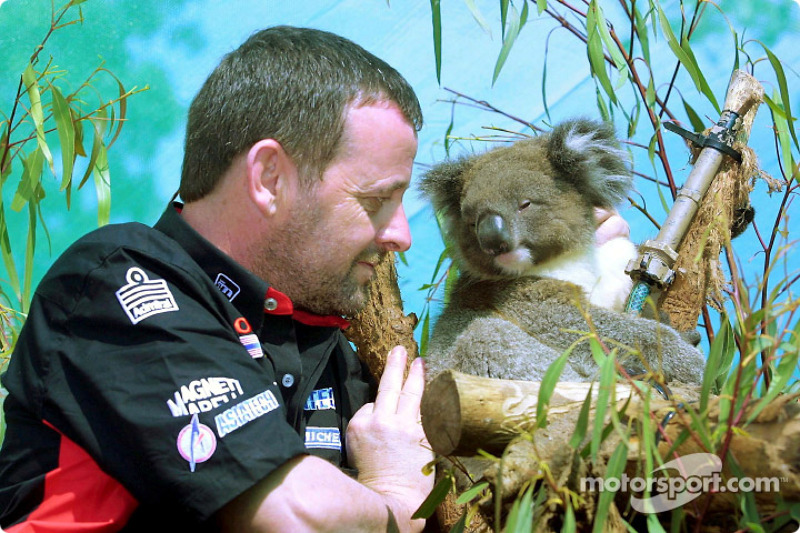 Visit at the Melbourne Zoo: Paul Stoddart with a koala