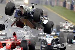 First corner accident: Ralf Schumacher flying over Rubens Barrichello