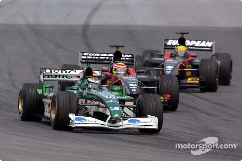 Eddie Irvine battling with Alex Yoong and Mark Webber