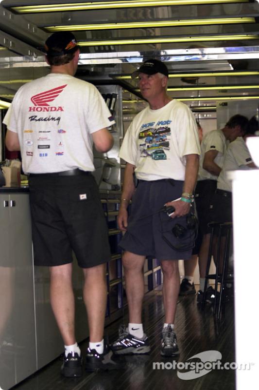 Racing Radio's Gary Coleman confers with Honda engineer