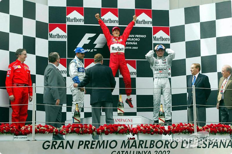 Podio: el ganador de la carrera Michael Schumacher, Juan Pablo Montoya y David Coulthard