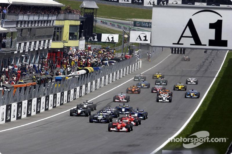 The start: Rubens Barrichello taking the lead in front of Michael Schumacher and Ralf Schumacher