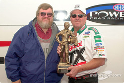 Motorsport.com's Greg Gage presents EMPA's Driver of the Year trophy to John Force; this turned out to be the highlight of John's day