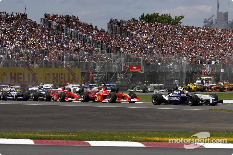First corner: Juan Pablo Montoya leading Rubens Barrichello and Michael Schumacher