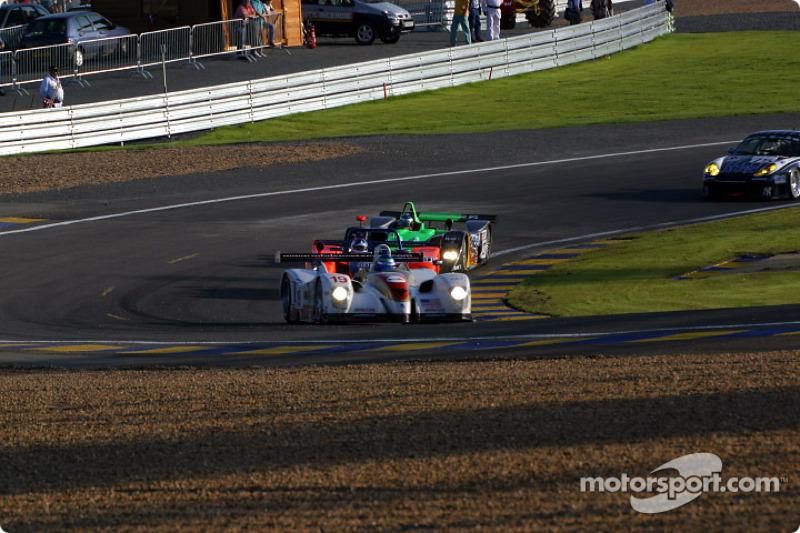 John Graham leading a group of cars