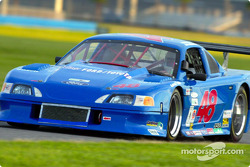 Tommy Riggins broke the American GT record with a 1:50.272 lap at 116.222 mph to earn the AGT class pole position