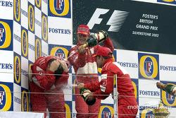 Champagne for Michael Schumacher, Rubens Barrichello and Ross Brawn