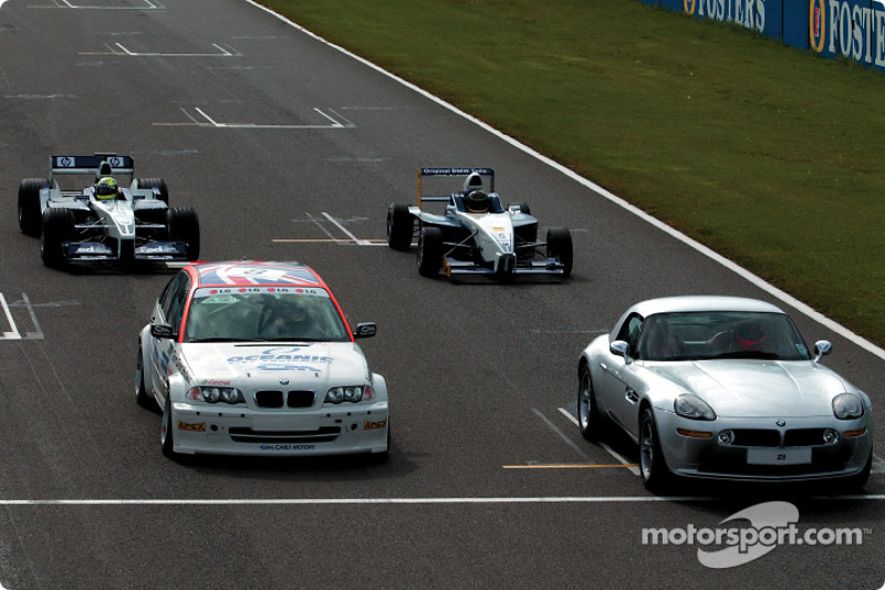 Ralf Schumacher in the WilliamsF1 BMW FW24, Bruno Giacomelli in the BMW Z8, Tom Coronel in the BMW 320i Touring car and Jörg Müller in the Formula BMW