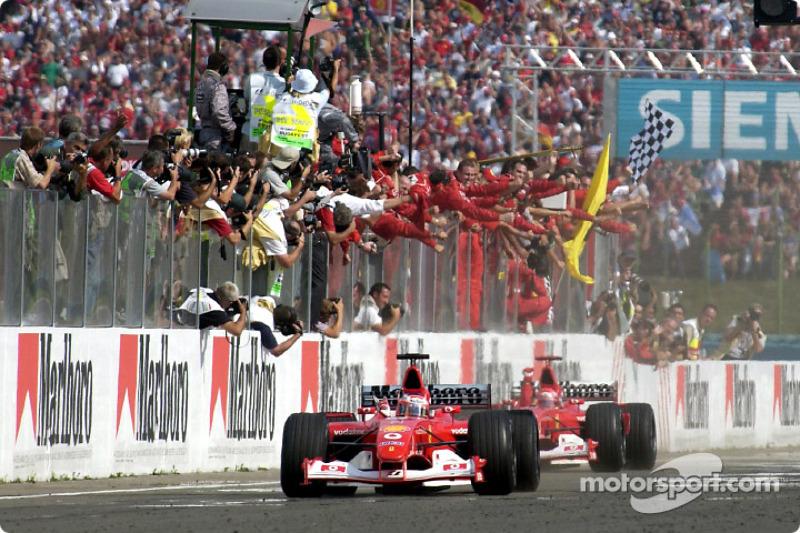 Rubens Barrichello taking the checkered flag in front of Michael Schumacher