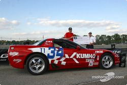 Steve Zink receives the 'Best Appearing Car at the 2002 Valvoline Runoffs' Award presented by Eagle One