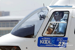 Dario Franchitti arrives in helicopter
