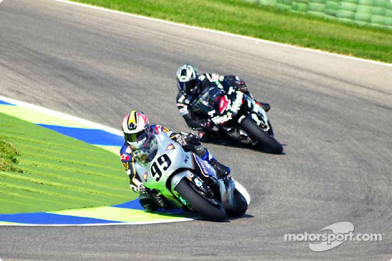 Jeremy McWilliams frente a Alex Barros