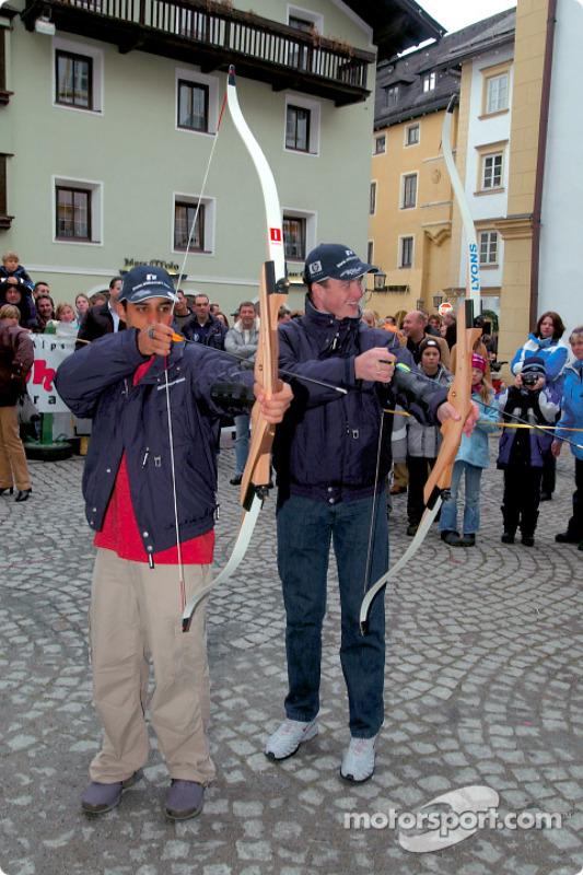 BMW Drivers Ralf Schumacher and Juan Pablo Montoya have a go at archery