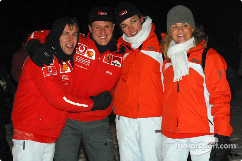 Luca Badoer and Michael Schumacher with their girlfriends