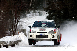 The Mitsubishi Lancer of Sylvain and Phillip Erickson flies over a bridge enroute to a dominant victory at the Rally Perce-Neige Maniwaki