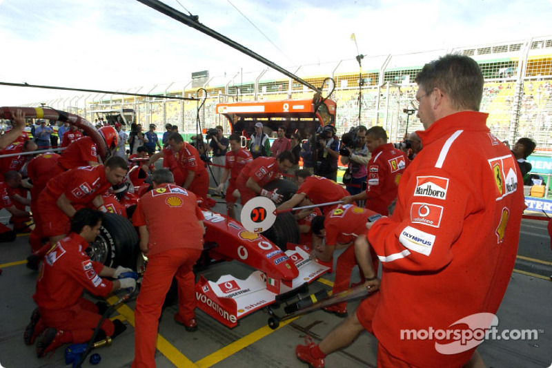 Ross Brawn supervises pitstop practice at Ferrari