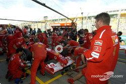 Ross Brawn supervises pitstop practice at Ferrari