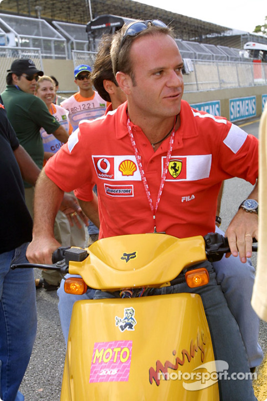 Rubens Barrichello on a scooter