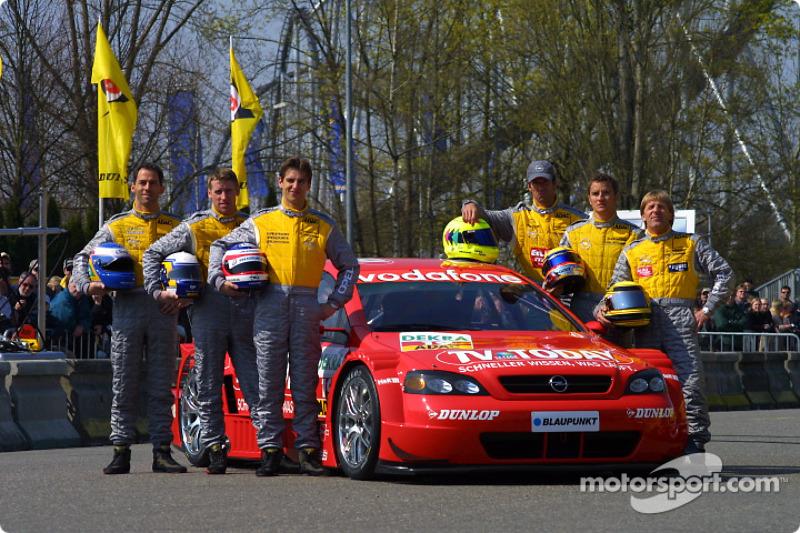 The 2003 DTM Opel drivers: Manuel Reuter, Alain Menu, Joachim Winkelhock, Jeroen Bleekemolen, Timo Scheider and Peter Dumbreck
