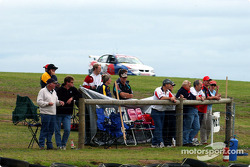 Spectators watch the warm up with K-Mart racer Rick Kelly in the background