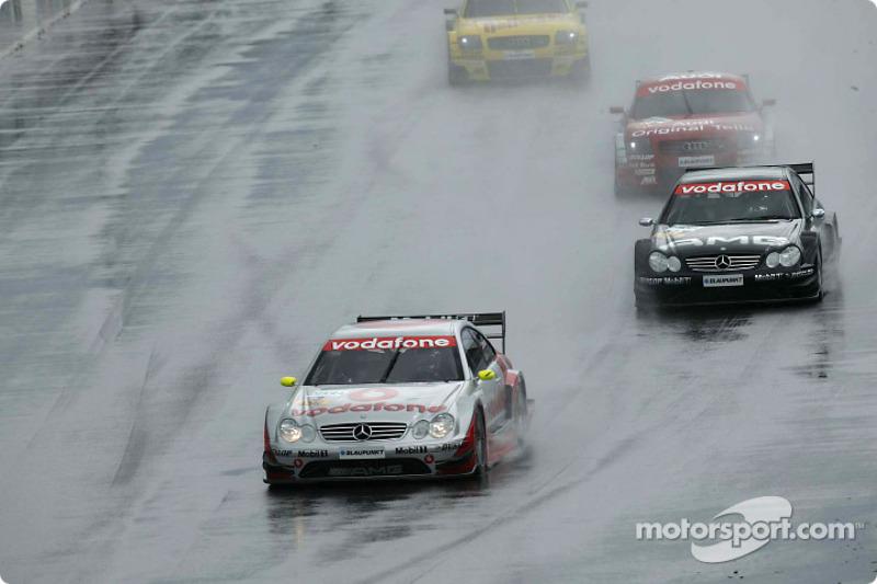 Bernd Schneider leads Jean Alesi